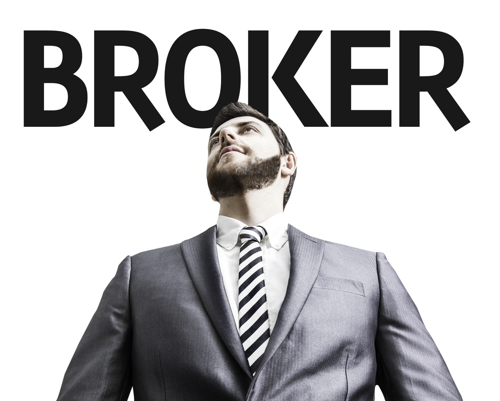 Business man with the text Broker in a concept image.jpeg