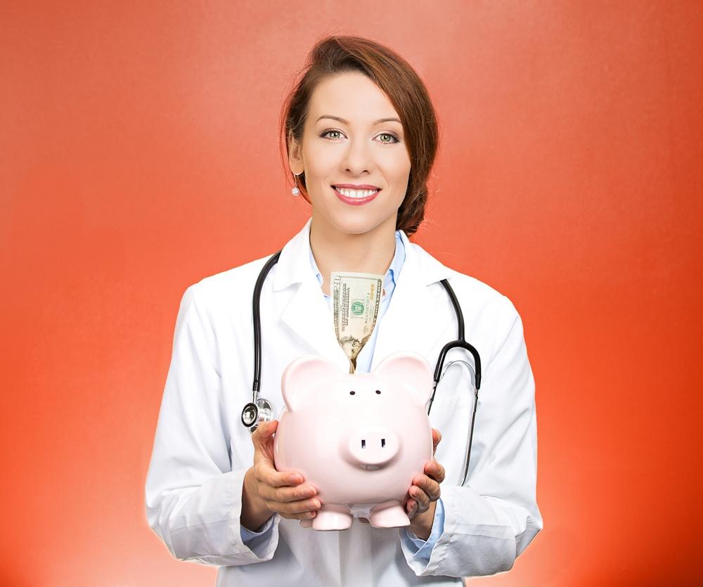 Closeup portrait female health care professional, doctor, nurse with stethoscope holding piggy bank, dollar bill, isolated red background. Medical insurance, medicare reimbursement, reform concept.jpeg
