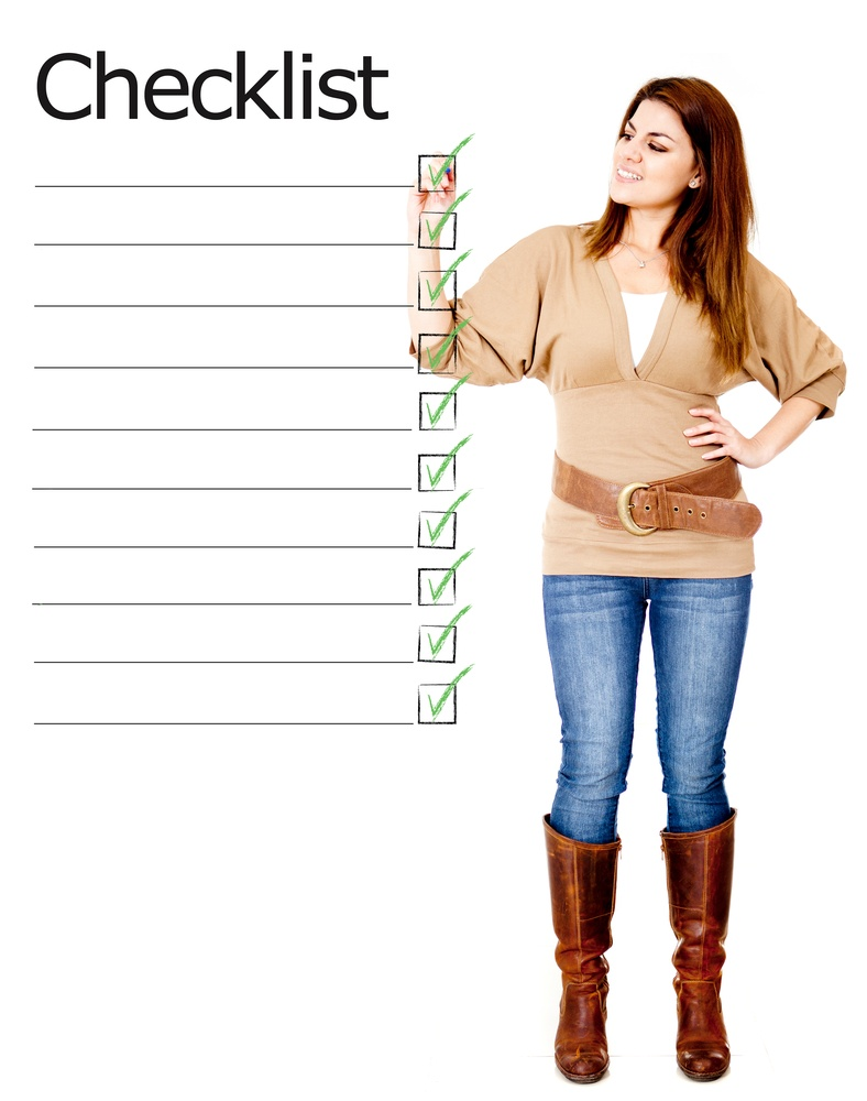 Woman ticking on a checklist - isolated over a white background.jpeg