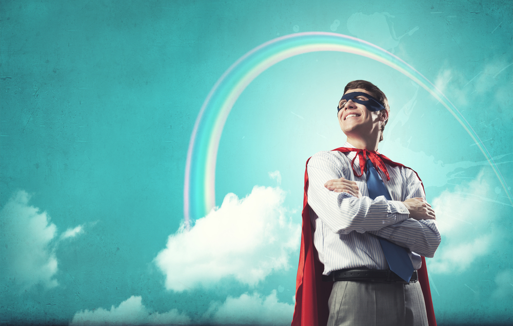 Young confident super businessman in mask and cape-1